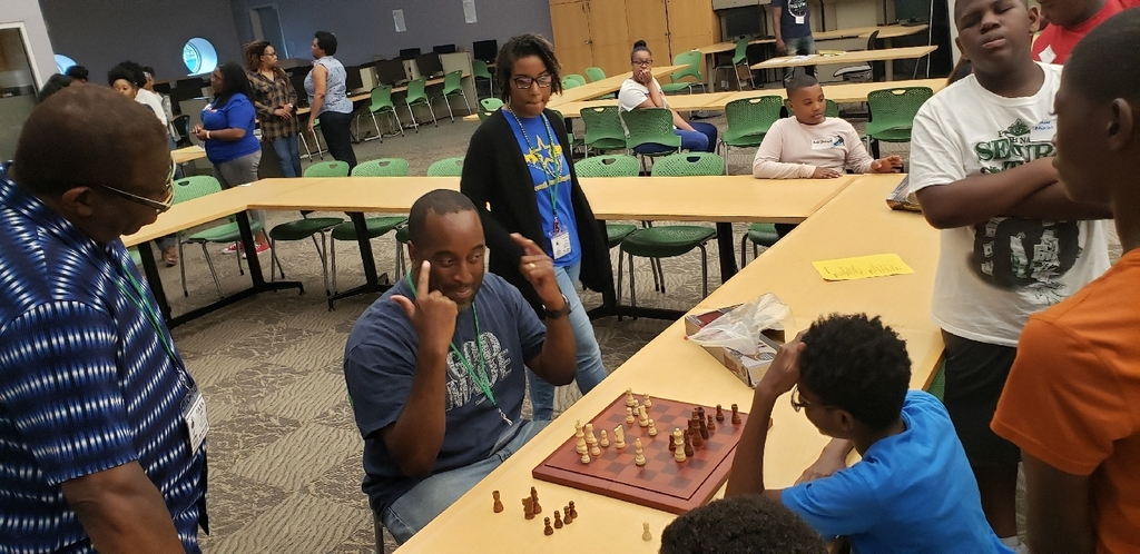 Mr. McCree pulling in new chess recruits already.  Staff members are in blue tops.